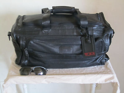 """TUMI all leather Duffle bag """" travel in style"""""""