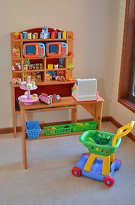 Childrens pretend play shop with trolley, microwaves, goods, fruit, cash registe