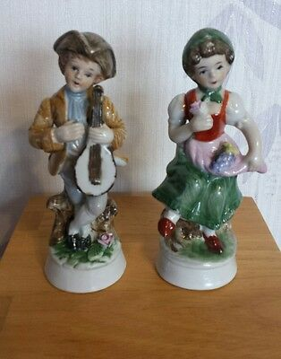 Vintage china figurines boy & girl.