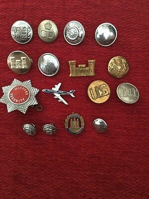 A Vintage Mix Of Badges And Buttons