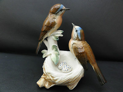 Karl Ens Double Bird figurine. Pair of birds with a nest and speckled eggs.