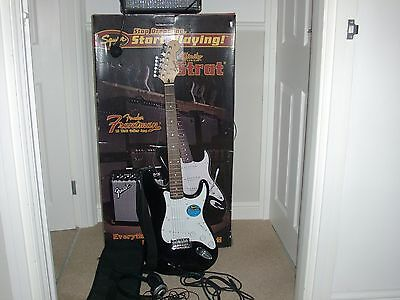 boxed fender electric guitar starter set with amp and accessories
