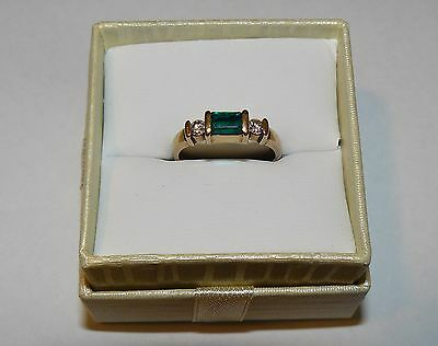 9ct yellow gold ring with Emerald and Diamonds, Comes with $550 valuation.