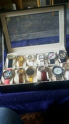12 Watches in a Display Case