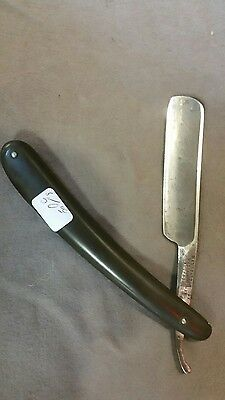 antique straight razor manufactured by Wade and butcher Sheffield