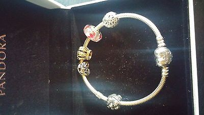 Authentic Pandora bracelet with 5 Authentic Pandora Charms