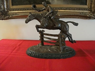Vintage Hunter whiskey first over the bar advertising statue