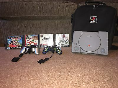PS1 with 2 Controllers, 4 Games And Carry Case