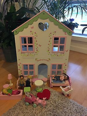 Wooden Dolls House With Dolls And Furniture