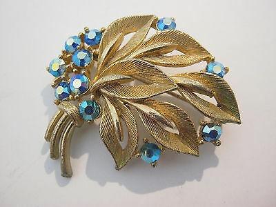 Lisner vintage signed leaf flower brooch with blue rhinestones, textured gold