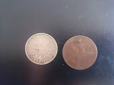 French coins. 1917: 1 franc and 1912: 5c