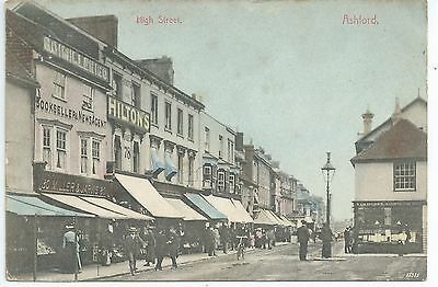 Printed postcard of Ashford High street .Kent in ave condition.