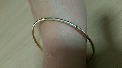 9 ct solid gold slave bangle. 11 grams.
