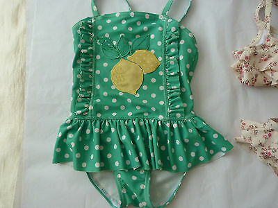 Next  girls  beach green swimming suit  9-12 mnts