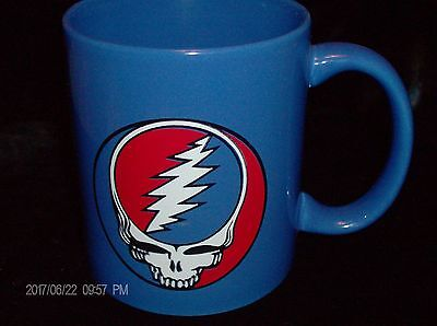 Grateful Dead coffee mug lettered one side and decal on front