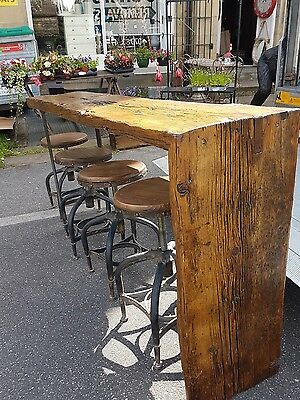 Industrial reclaimed wood breakfast bar with four stools