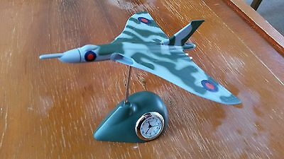 Miniature quartz clock with 1:43 Scale model vulcan on stand.