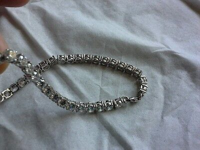 Solid silver and clear faceted stone set tennis bracelet