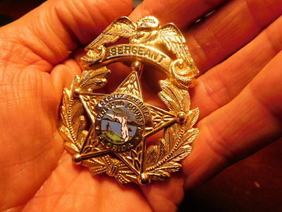 Vtg Obsolete old style eagle top  VOLUSIA COUNTY FLORIDA DEPUTY SERGEANT badge