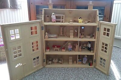* Classic four storey wooden dolls house with all furniture plus people *