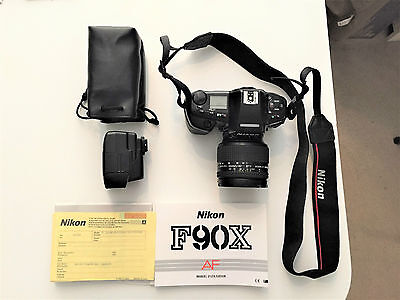 Nikon F90X Camera complete with Nikkor Lens and Nikon Flash.