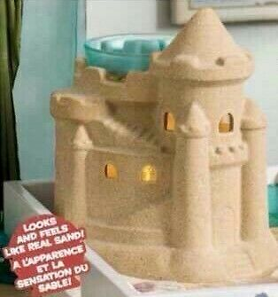 scentsy summer sand castle warmer.