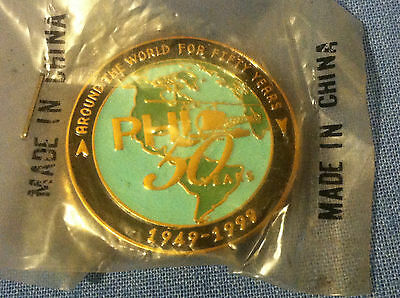 """Petroleum Helicopters (PHI) """"Around the World for 50 Years"""" Pin RARE!! SEALED!"""