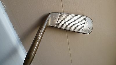 Double face brass headed putter   steel shaft with wooden handle 34.5 inch