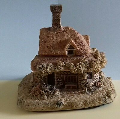 Resin cottage, for fairy gardens?  or to add to a collection.