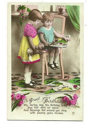 Toys - a photographic postcard of children with a doll