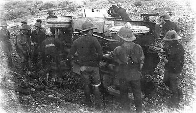 WW1 WWI British soldiers in pith helmets with overturned vehicle