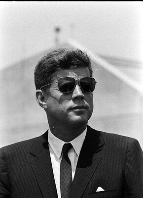 John F. Kennedy , Kennedy looking cool in his Ray Ban sunglasses.