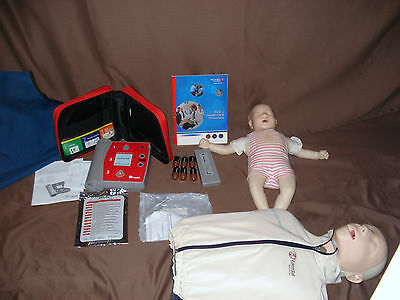 Laerdal Little Anne AED Training System w/ BABY ANNE + Laerdal AED trainer