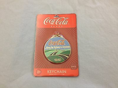"""Coca-Cola """"Along the Highway to Anywhere 1949""""  Round Logo Keychain"""
