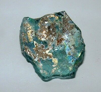 .ancient roman glass fragment with very lovely patina amazing.