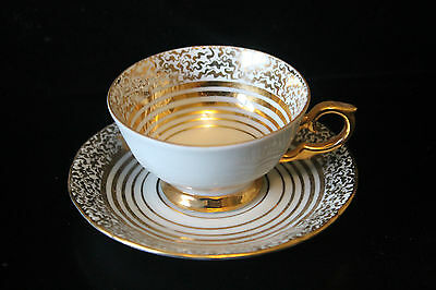 Demitasse tea cup and saucer made in East Germany White with Gold Trim.