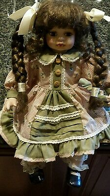"""Porcelain doll 16"""" used in great condition"""
