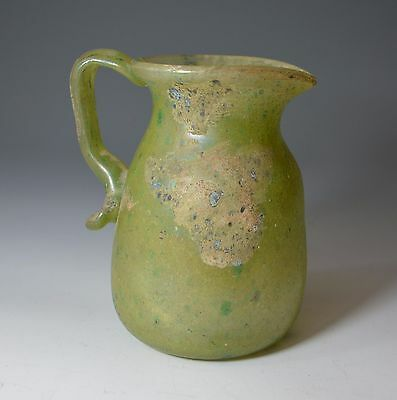 A large ancient Phoenician green glass jug  circa Bc 100