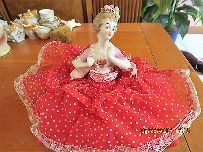 Pin cushion doll with pin cushion attached