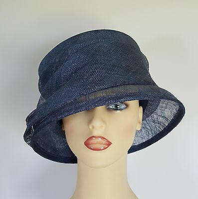 British Home Stores BHS Natural Fibres Sea Blue Formal Dress Hat Church Wedding Natural Fibres Sea Blue Formal Dress Hat Church Wedding. Ladies Unlined, Light Weight, Sea Blue Hat With Sea Blue Bow and Navy Blue Rosette and Ribbon Detail.