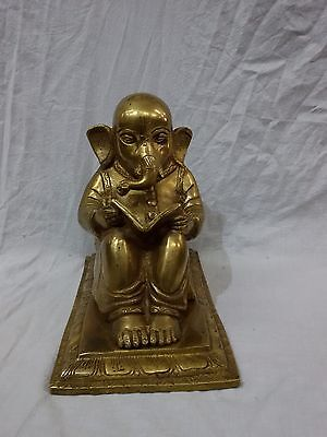 Brass book reading ganesh statue handicrafts product by BharatHaat™BH01372