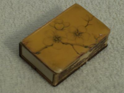 Vintage--Small Match Box 1 3/4 X 1 1/8 Inch -- Gold Tone Metal Over Cardboard Ba