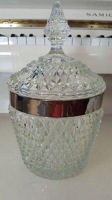 Diamond Cut Glass Canister With A Silver Lid And A Tower Cover