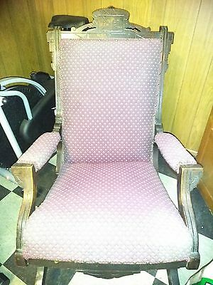 elegant antique rocking chair.  Stately and comfortable. Beautiful carved wood.
