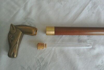 Wooden walking stick with brass horse's head and whisky container with cork