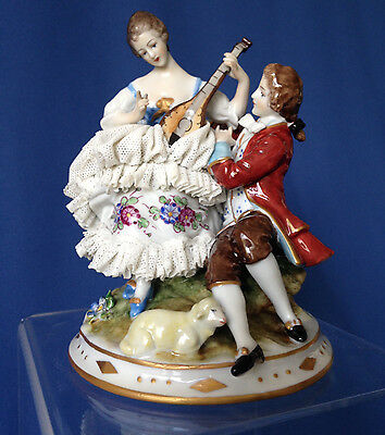 Antique Volkstedt lace porcelain courting couple with mandolin, lamb