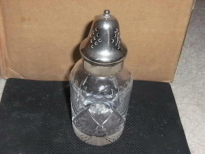 Vintage cut glass sugar shaker with silver plated top