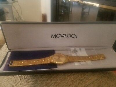 Movado Gold Wrist Watch. In Original Box With Manual And Extra Link