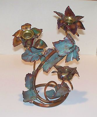 Metal Art Decorative Brass Candle Holder - Flowers with a patina look .