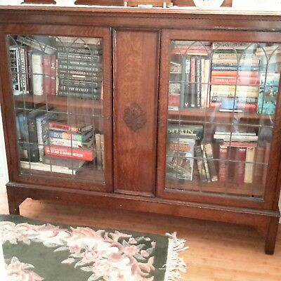 large glass fronted dark oak bookcase